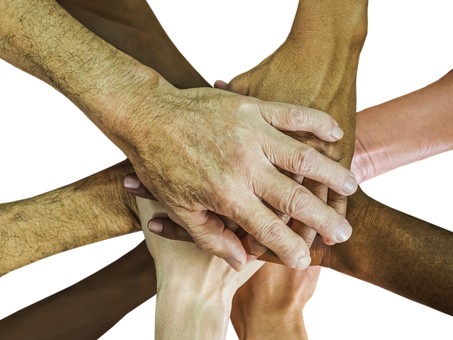 Hands together, representing many different races and ages